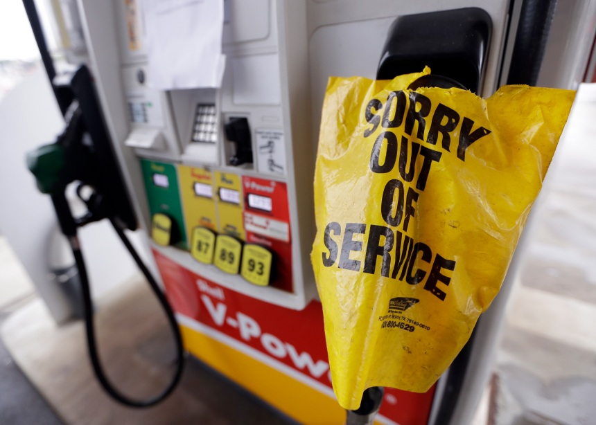 A bag covers a pump handle at a gas station that has no fuel to sell Saturday, Sept. 17, 2016, in Nashville, Tenn. Fuel supplies in at least five states are threatened by a gasoline pipeline spill in Alabama, and the U.S. Department of Transportation has ordered the company responsible to take corrective action before the fuel starts flowing again.  (AP Photo/Mark Humphrey)